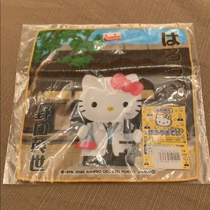 Hello Kitty as a scientist hand towel from Japan